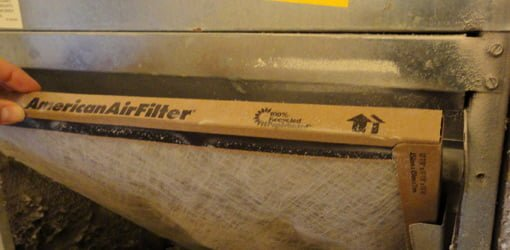 Edge of air filter with arrow.