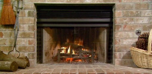 Fire burning in fireplace.