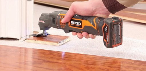 RIDGID JobMax Multi Tool cutting a door jamb.