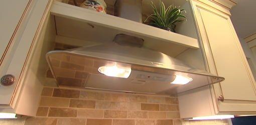 Stainless steel kitchen range hood.