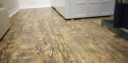 New laminate floor in laundry room.