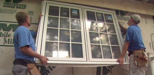 Installing new energy efficient windows on home.