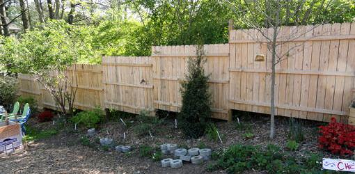 Stepped fence built using preassembled panels.