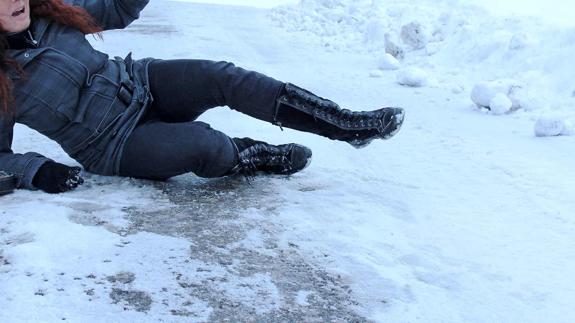 Woman slips on icy driveway during the winter