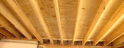 Floor joists in room.
