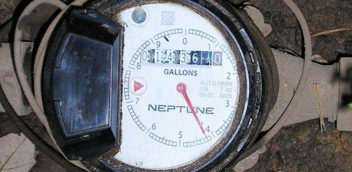 Checking water meter for plumbing leaks.