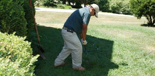 Probing for top of septic tank to inspect.