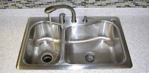 Kitchen sink with garbage disposal.