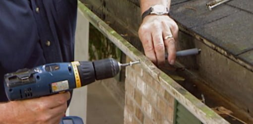 Installing gutter screws.