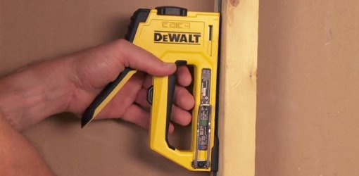 DeWALT 4-in-1 Heavy Duty Staple and Brad Tacker stapling into stud.