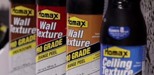 Cans of Homax wall and ceiling spray texture.
