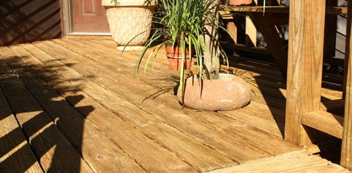 Pressure treated wood deck after cleaning and sealing.