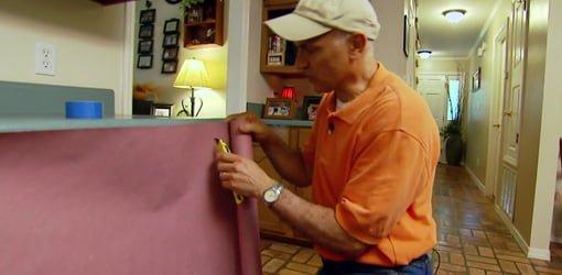Joe Truini cutting rosin paper to prevent tearing.