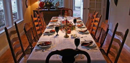 Dining room table set for holiday feast.