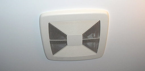 Bathroom exhaust vent fan on ceiling.