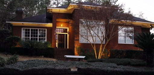 Front of house after dark with new landscape lighting turned on.