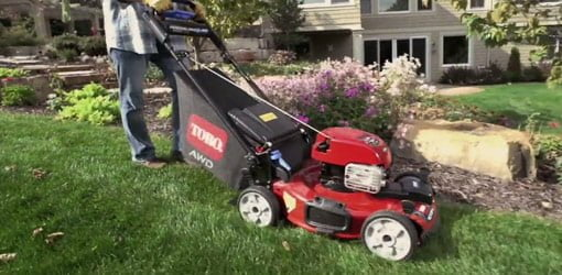 Cutting grass with a Toro Recycler All-Wheel Drive lawn mower.