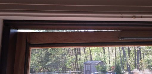 Gap at top of sagging screen door.