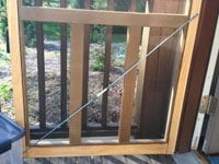Turnbuckle installed on screen door.