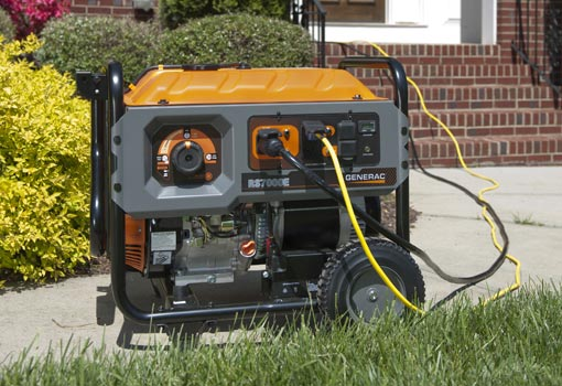 Generac portable generator in front of house.