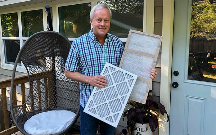 Danny Lipford displays air filters at Chelsea Lipford Wolf's home