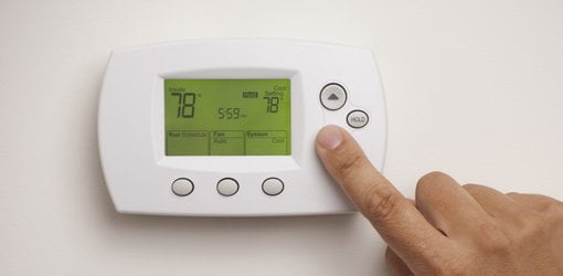 Adjusting programmable thermostat.