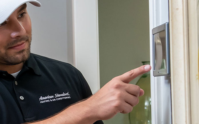 Man sets American Standard AccuLink thermostat