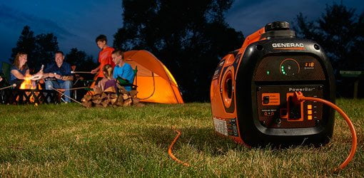 Family camping at night with portable generator.
