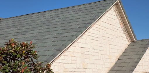 Polymer slate tile roofing on roof.