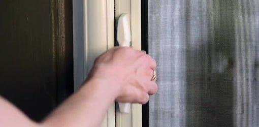 Opening a retractable screen door.