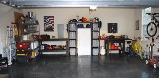 Garage with storage shelves.
