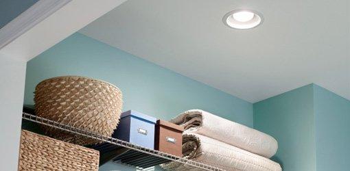 Broan recessed light vent fan above closet shelf.