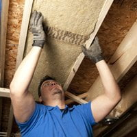 Installing Roxul insulation.