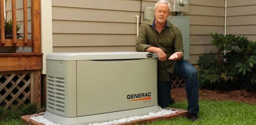 Danny Lipford in yard next to house with Generac Synergy home standby generator.