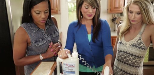Woman spraying Wet & Forget Indoor Mold+Mildew Disinfectant Cleaner on kitchen counter.
