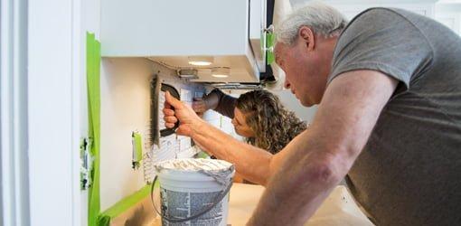 Applying thin-set adhesive to wall for backsplash.