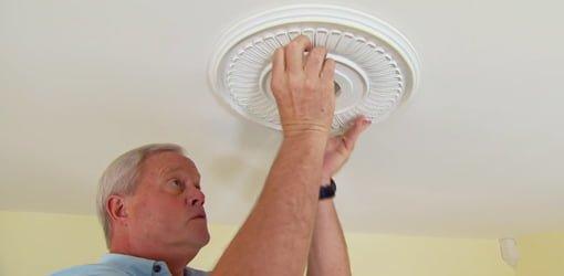 Danny Lipford installing a ceiling medallion.