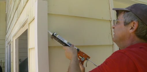 Caulking cellular PVC corner board to siding.