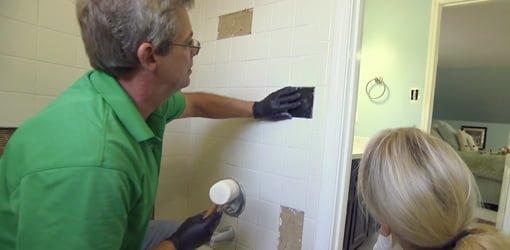 Allen Lyle replaces tile on bathroom tub surround.