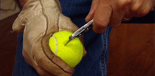 Cutting tennis ball to create a scuff remover