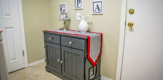 Upcycled hutch, turned kitty litter box, inside a home
