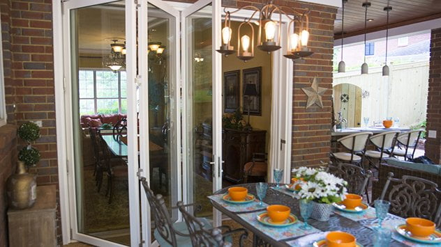 The new folding door creates a seamless transition from the indoor and outdoor dining areas.