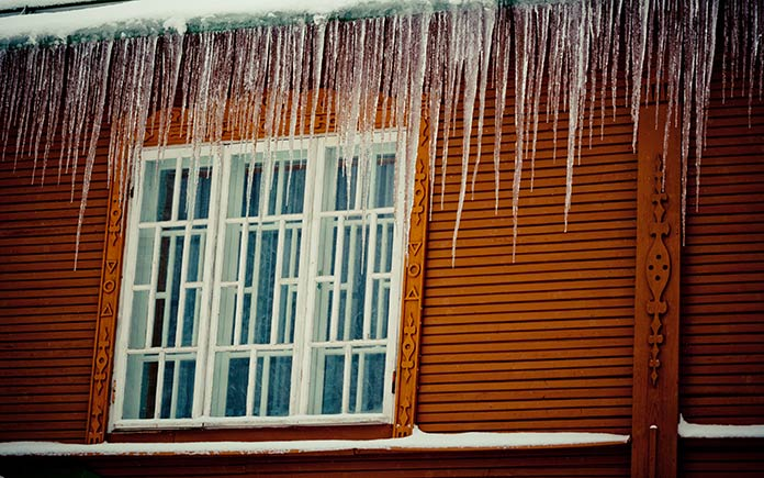 Ice dams on house in winter