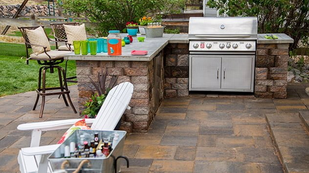 The outdoor kitchen featured a grill and concrete countertops,
