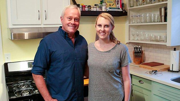 Danny Lipford and Chelsea Lipford Wolf in a kitchen with a Broan Tenaya range hood.