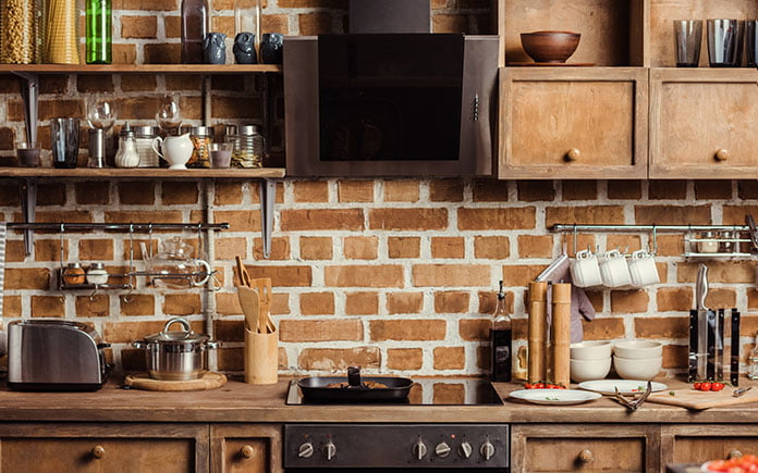 Shaker cabinets in old-fashioned kitchen with brick walls