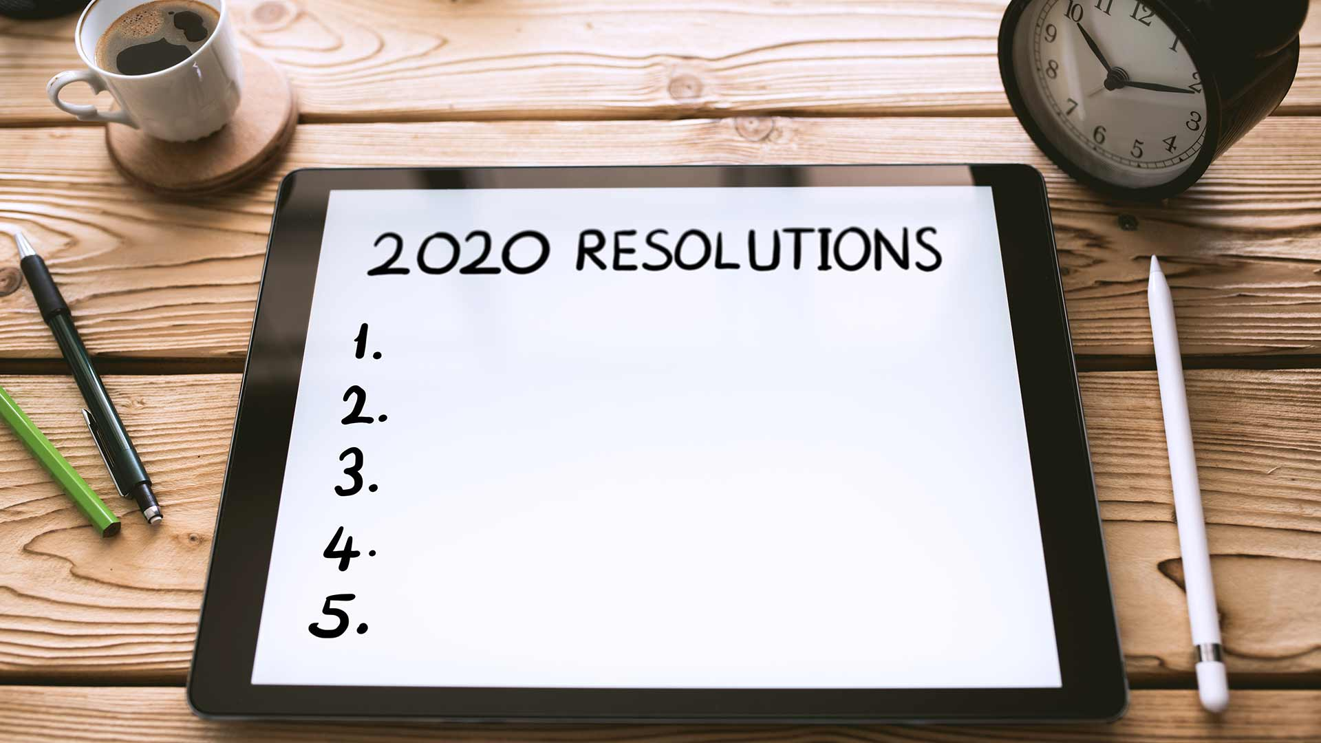 "Tablet with the words, ""2020 Resolutions"" on it"
