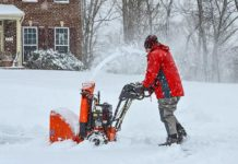 Danny Lipford uses snow blower during winter