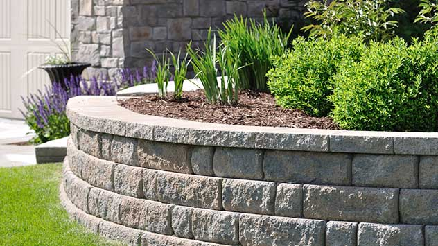How to Build a Block Retaining Wall | Today's Homeowner