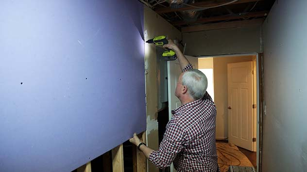 Danny Lipford installing drywall